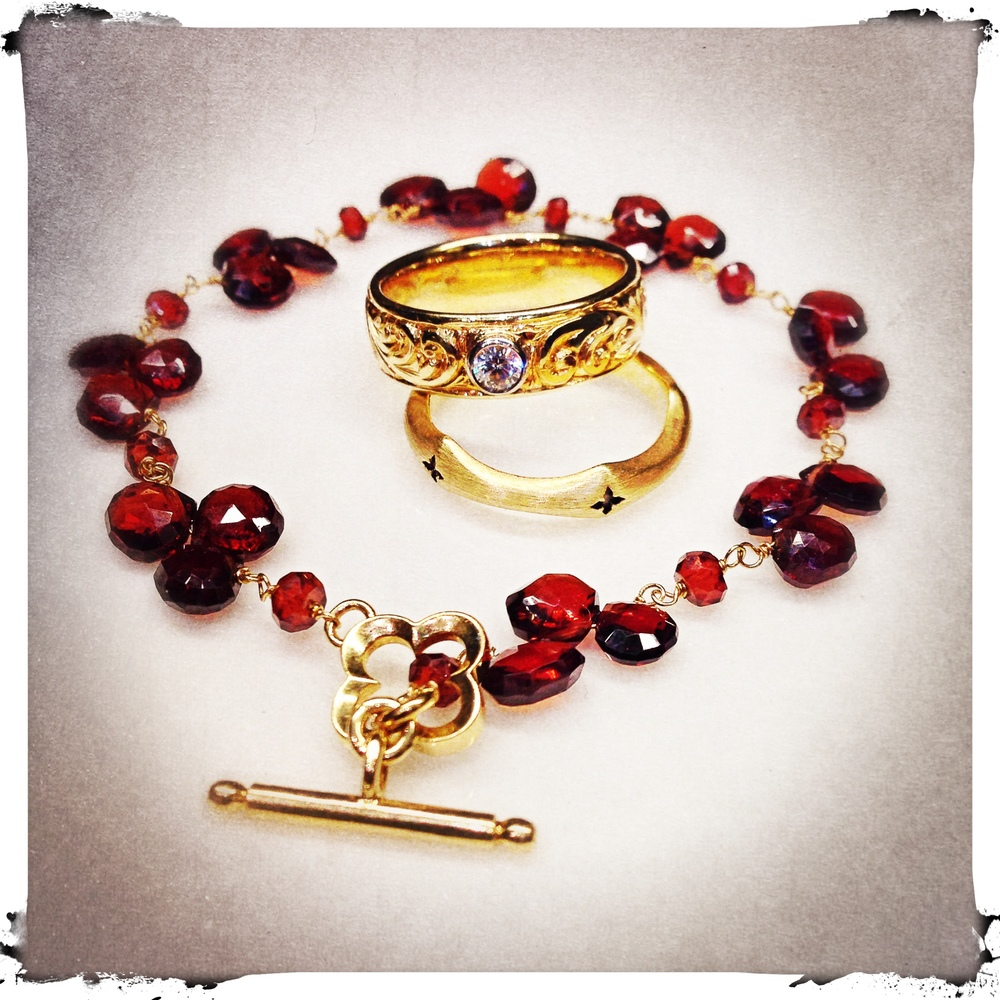 Garnet and gold bracelet, Morgaine satin finish ring and hand engraved Luxe ring