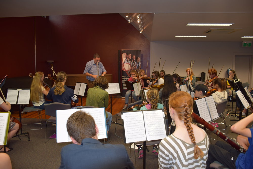 The Riverina Youth Orchestra doing a workshop with renowned Australian conductor, broadcaster and educator Graham Abbott.
