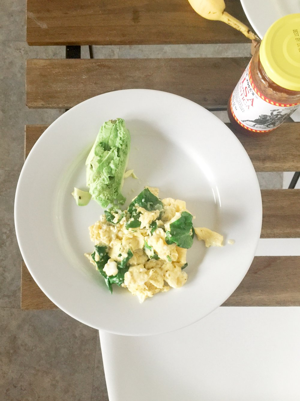 Spinach and eggs with avocado and salsa