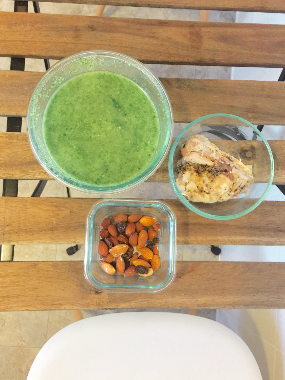 Spinach broccoli coconut cream soup, seasoned chicken thigh, almonds and raisins