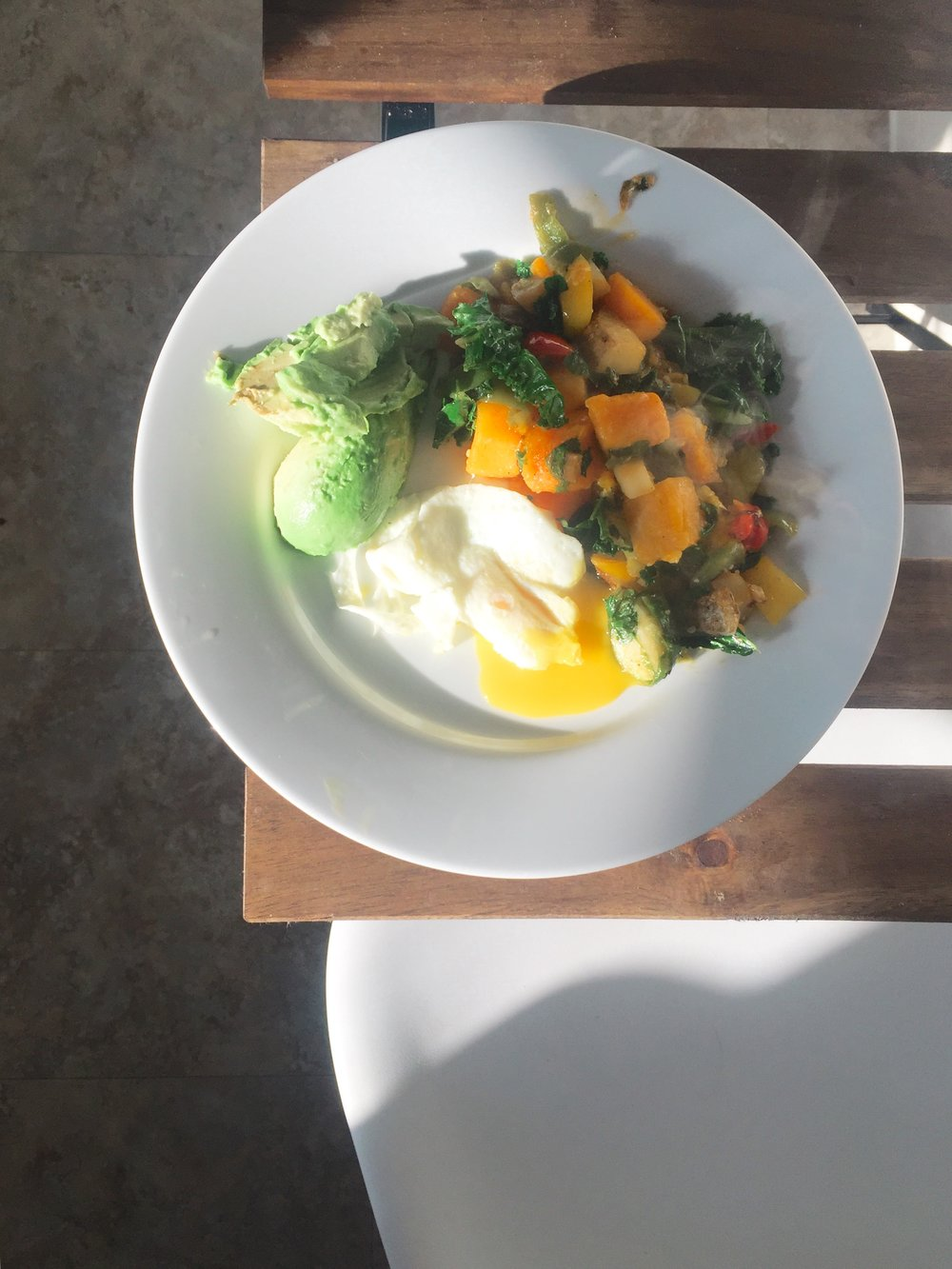 Butternut squash, potato, peppers, and kale with eggs and avocado