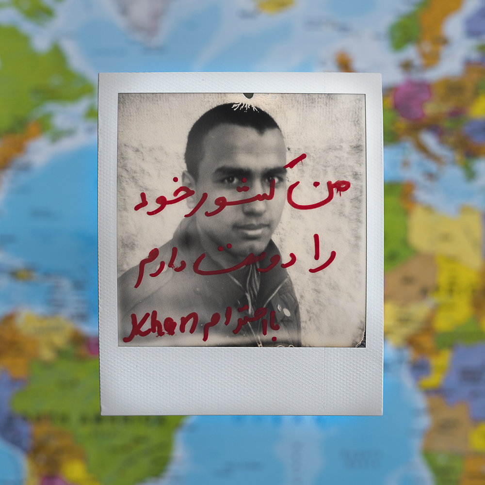 "Khan/Afghanistan/14 years old/ Kahn's father was killed by Taliban on 2014. his mother saved money to help her son escape from the armed conflict in Afghanistan and start his journey to Europe.                          Kahn wrote on the picture ""I love my Country"" in Persian."