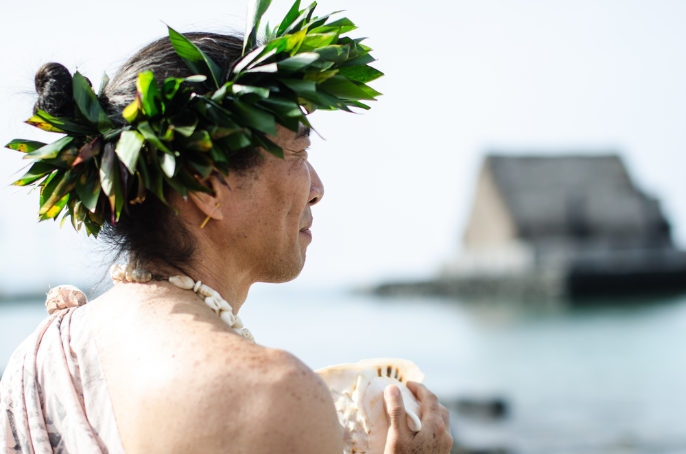This is a native Hawaiian in traditional dress, at the 195th anniversary celebration of Christians arriving on the Island of Hawaii.