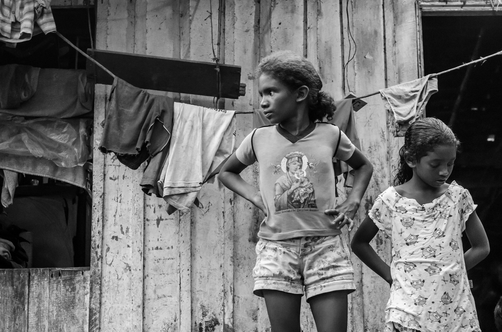 Little girls outside their grandmother's home in Arapapuzinho, in the Amazon.