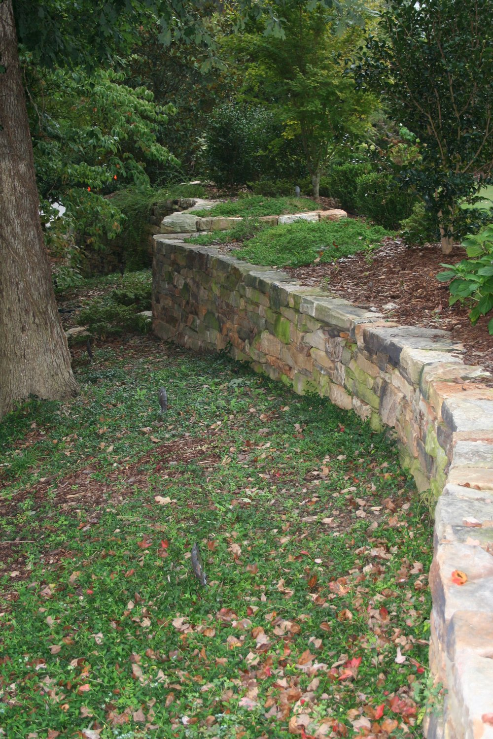 Curvilinear stone wall built by European Stone Masonry LLC