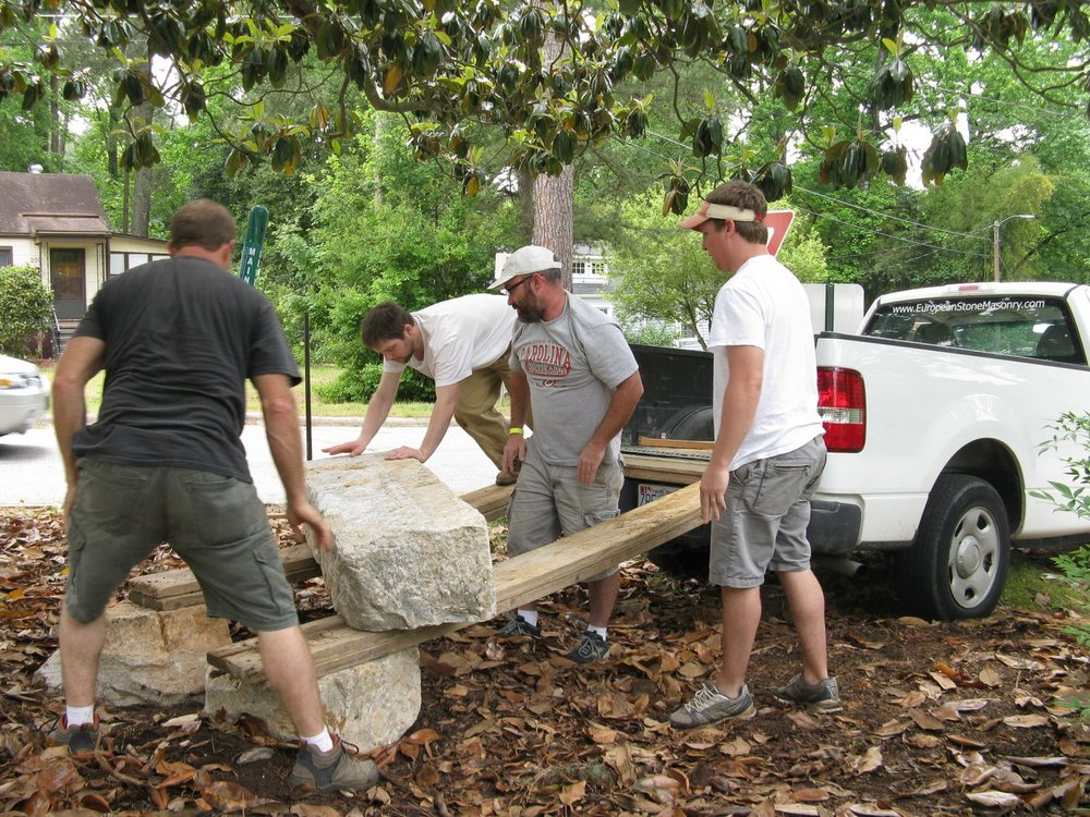 Belvidere Park residents moving granite bench into place
