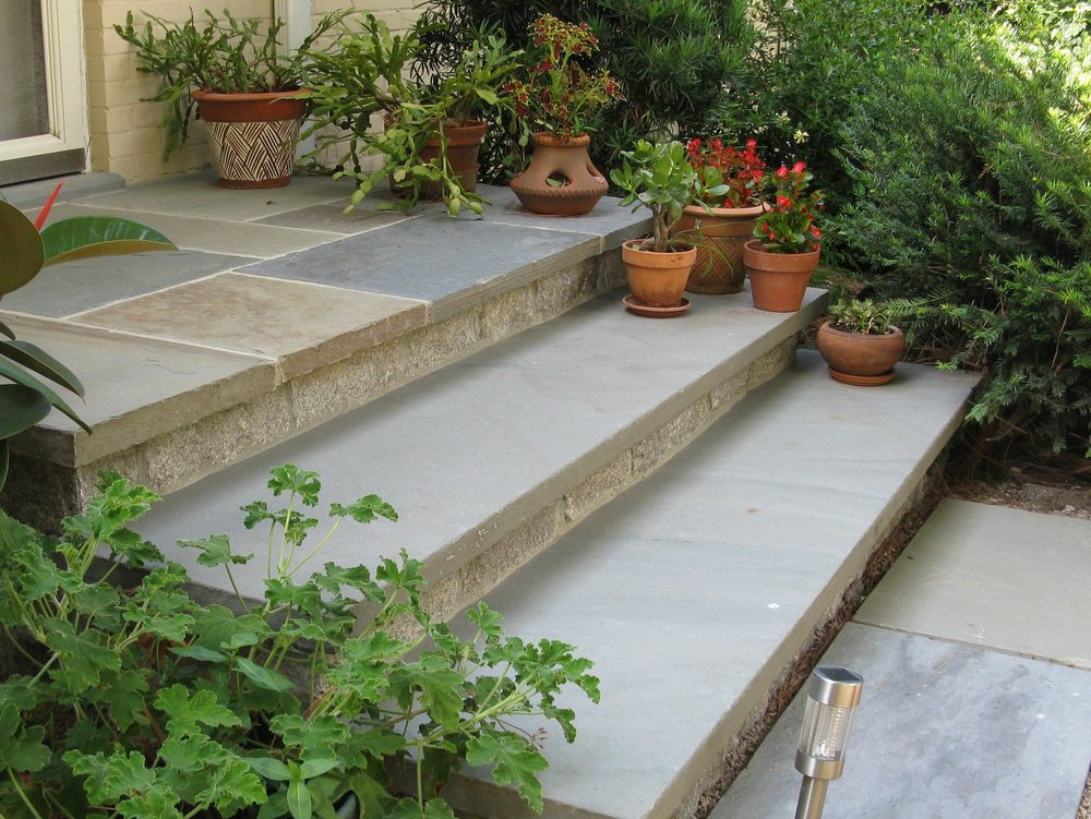 A bluestone and granite front proch