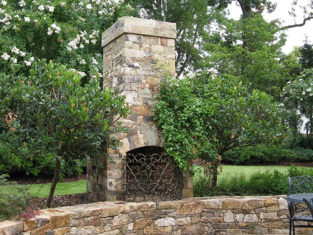 An outdoor fireplace crafted with tightly fitted stones