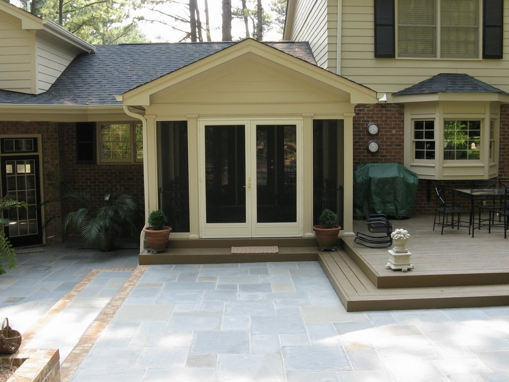 A stone patio with a complicated drainage pattern