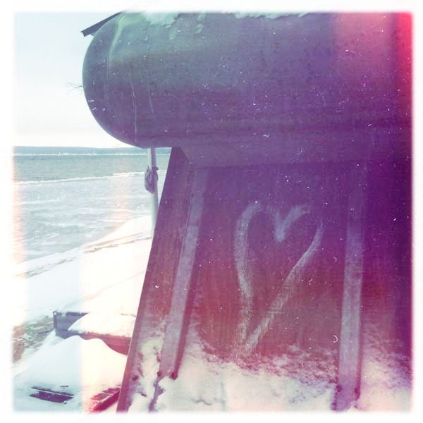 You can find love beneath the surface of a lot of things if you care to look. I found it beneath this boat on the barren coast of Higgins Lake.