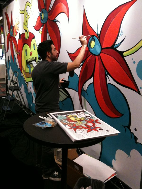 Live artist at the Curious Paper booth. Also signing posters. #HOWlive