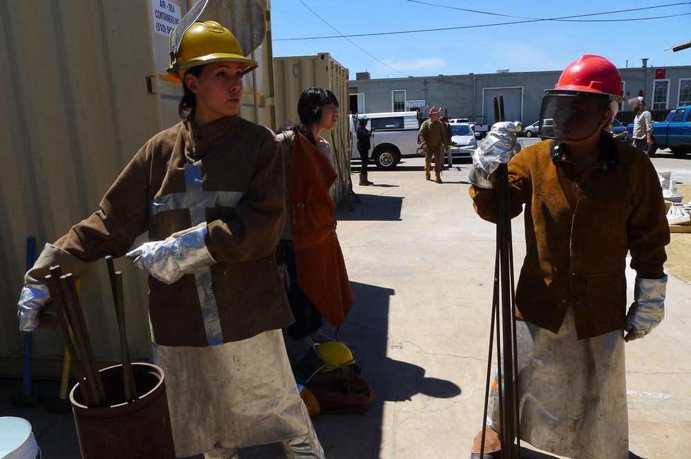 Melanie Sharr assisting the poker crew during the annual iron pour at San Jose State University's Foundry.  Photo © Aimee Santos