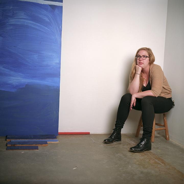 Devon McKnight next to a piece in her Advancement to Candidacy work at San Jose State University. Photo © Aimee Santos