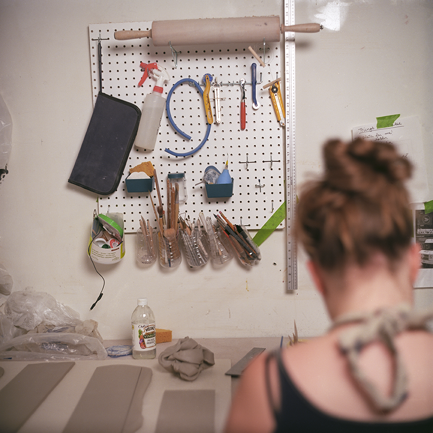 Slade's studio is organized so that not only can she see what she has available but within arm's reach and immediate access to make a fast mark and continue on with more details. Photo © Aimee Santos