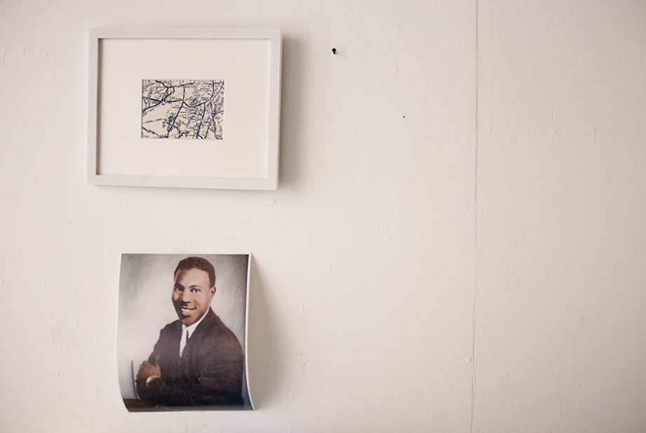Family plays a big part of Harris' work so it is only natural for her to have a portrait of her grandfather hanging on her studio wall.  Photo © Aimee Santos