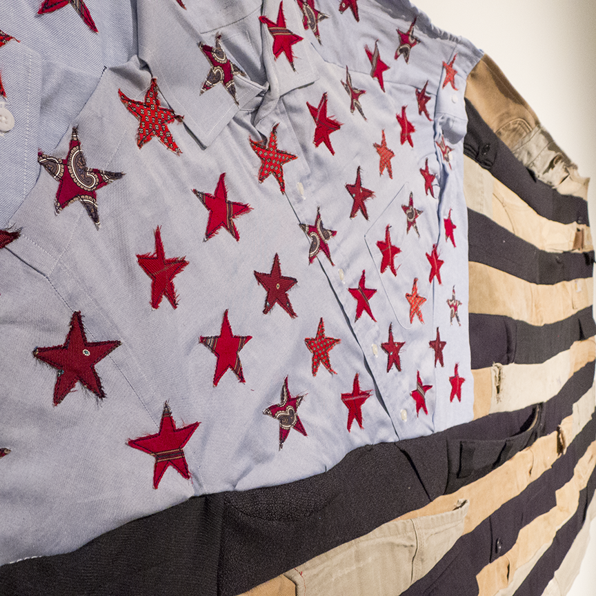 'Flag #1' in Carrington's Flag Series show layers of men's suits and Carhartt workman's pants as the strips and men's ties as the stars.  Photo © Aimee Santos