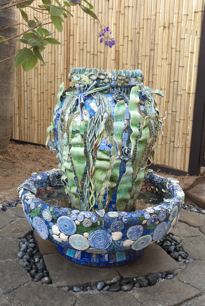 In addition to her ceramic and earthwork installations Wride also does commission pieces like this fountain that has thousands of individual ceramic pieces.  Wride plans out these fountains months in advance, knowing the color scheme, and details all in her head.  In the final execution of the fountain it is all intuitive as well as functional.  If you want one click the image and contact her for more information.  Photo © Aimee Santos