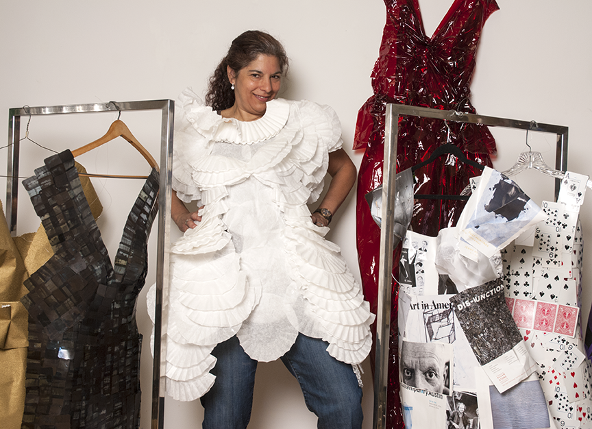 Jane Szabo poses with her dresses that all represent a facet of her life as well as showing us her bubbly personality.  Photo © Aimee Santos