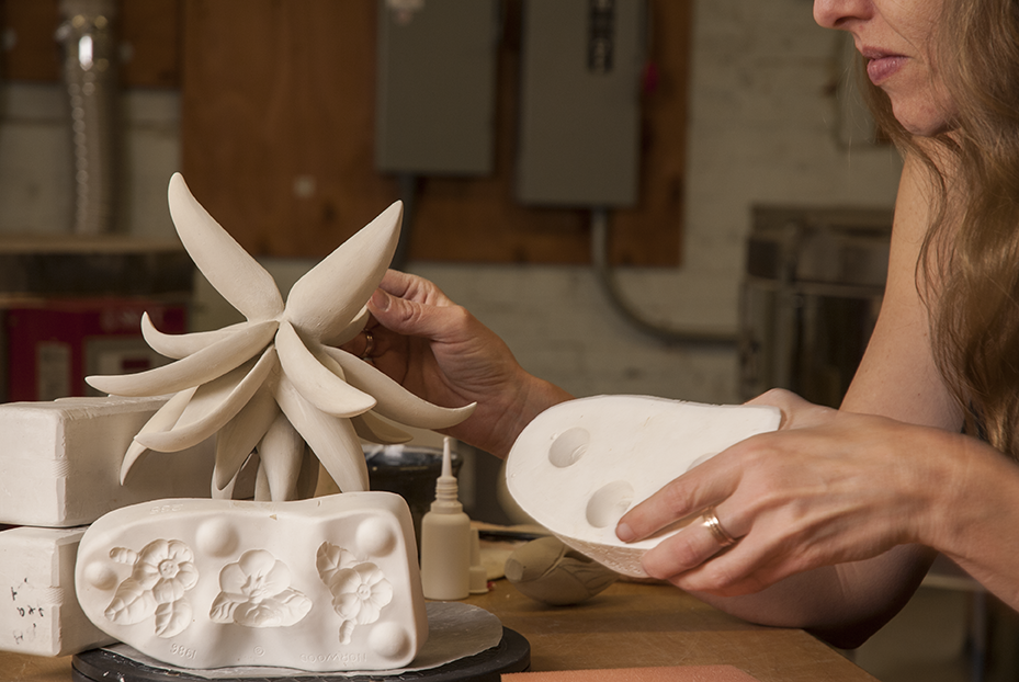 Jilek  uses plaster molds to help balance the setting of her sculpture during a work day in the studios of the American Museum of Ceramic Art in Pomona, CA.  Photo © Aimee Santos