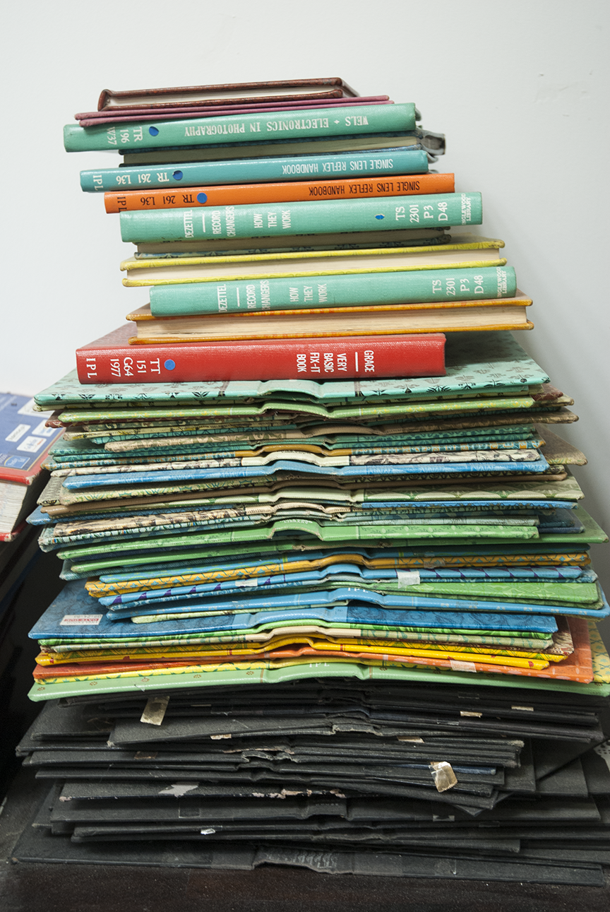 Stacks of books in all stages of manipulation exist throughout Gratkowski's studio.  Photo © Aimee Santos