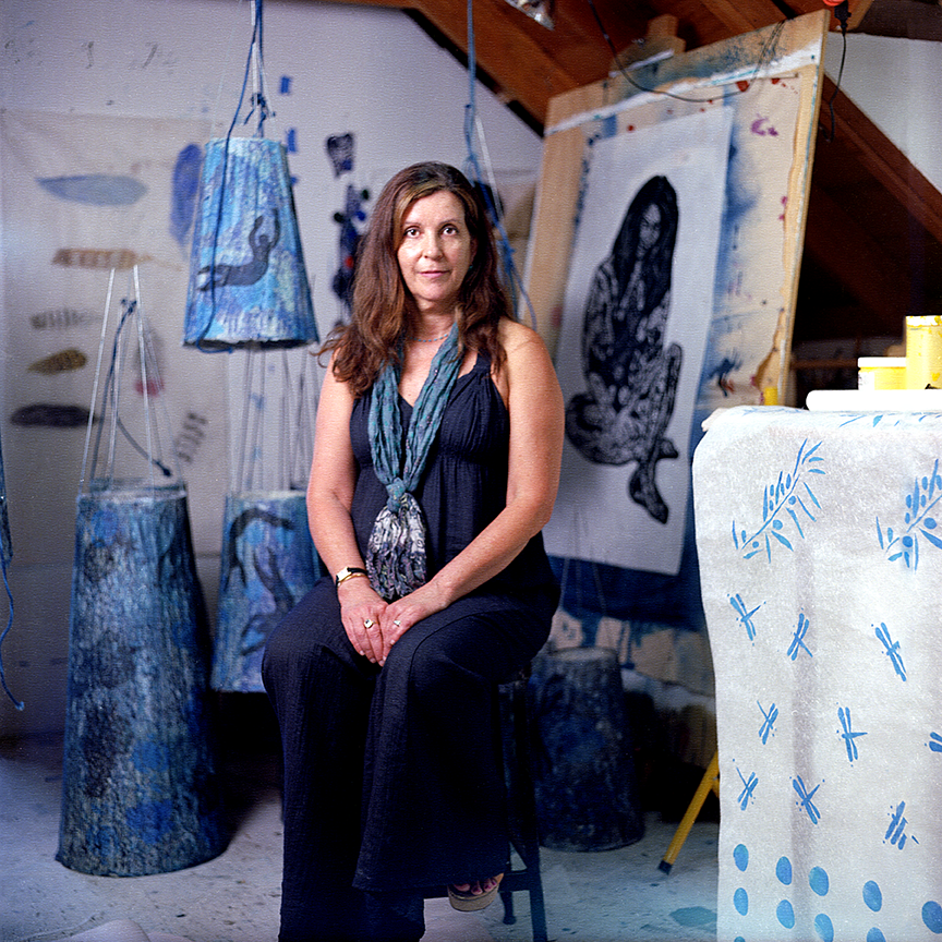 Cathy Weiss poses surrounded by her lanterns and print work at her studio in the Hollywood Hills of Los Angeles, CA.  Photo © Aimee Santos