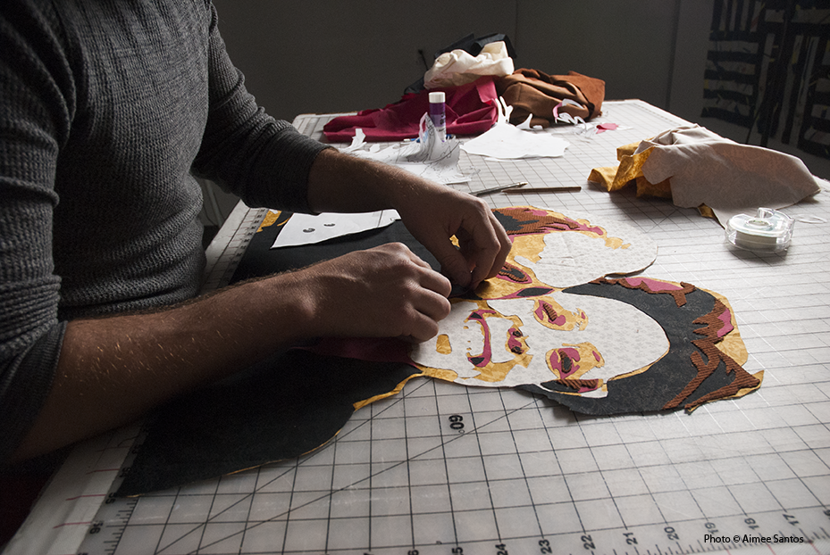 Haynes applies each piece of fabric in the process of making a portrait quilt for a client.  Photo © Aimee Santos