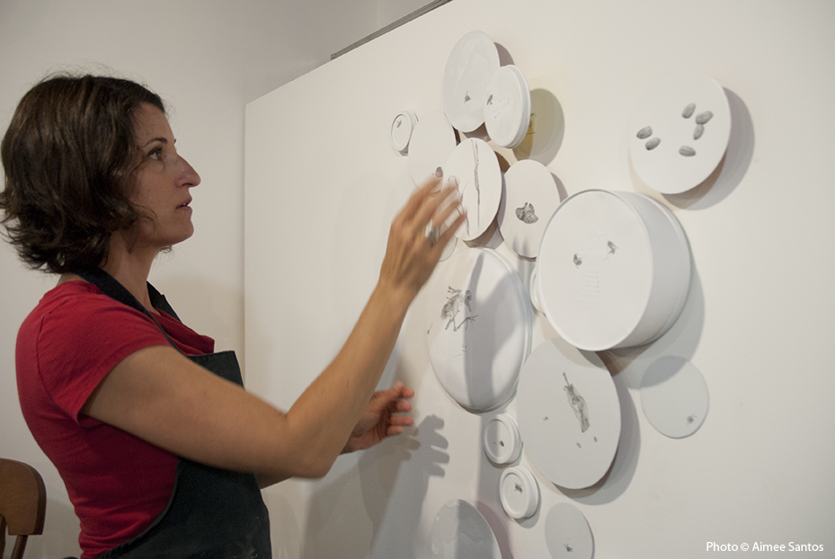 Terry Arena shows how her pieces, grouped together, create a modern version of a Honeycomb.  Photo © Aimee Santos