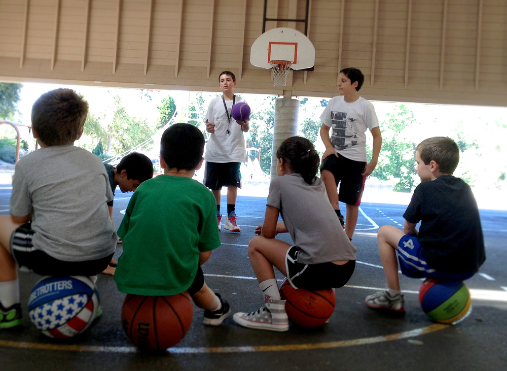 Coaches Jake and John lead the kids into the next set of basketball drills. Learn more »