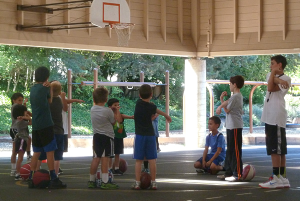 Kids learn all aspects of basketball fitness.