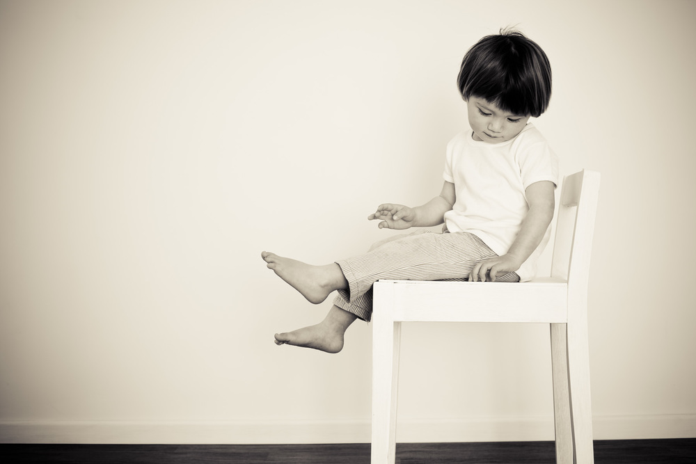 Boy on a chair