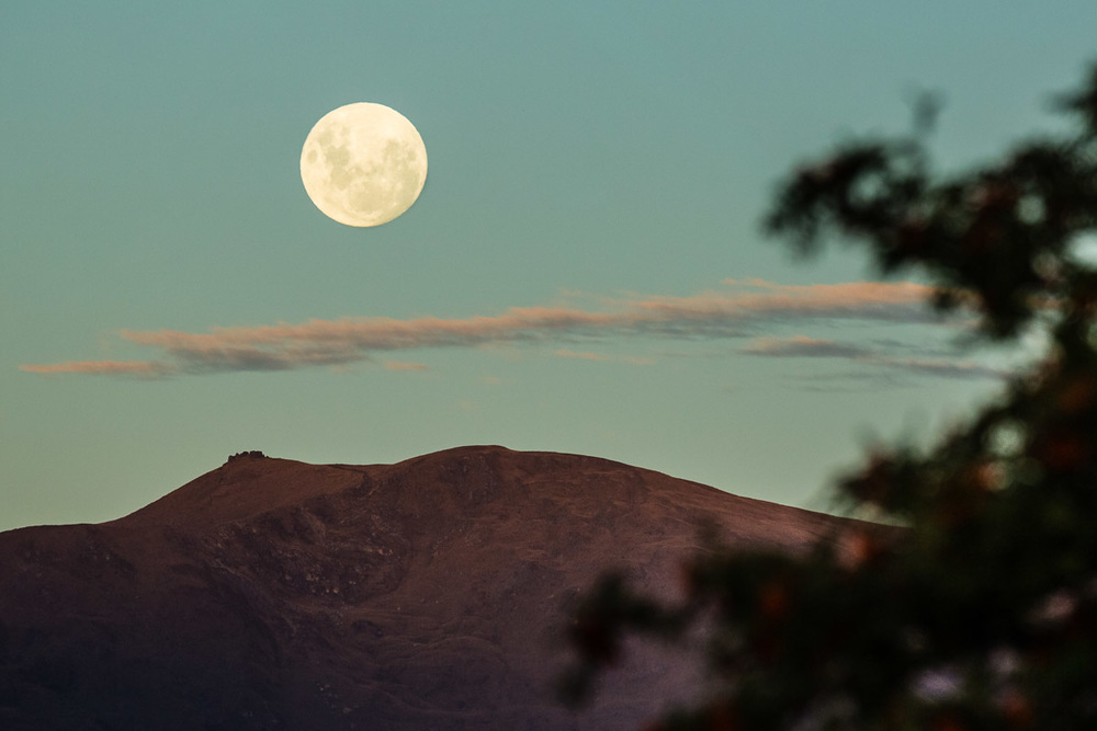 Full moon comes up over Crown Range