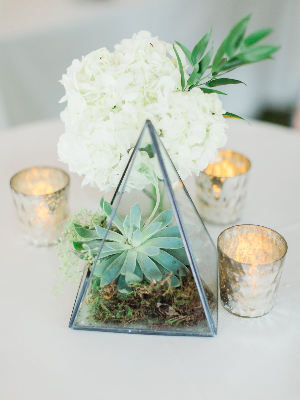 Jessie Barksdale Photography_bella flora 30a beach wedding inspiration_modern reception decor_succulent in glass terrarium
