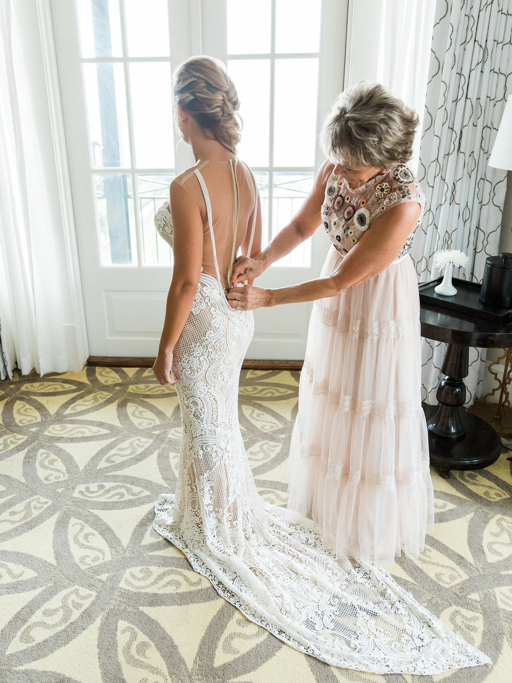 Jessie Barksdale Photography_bride getting dressed with mother