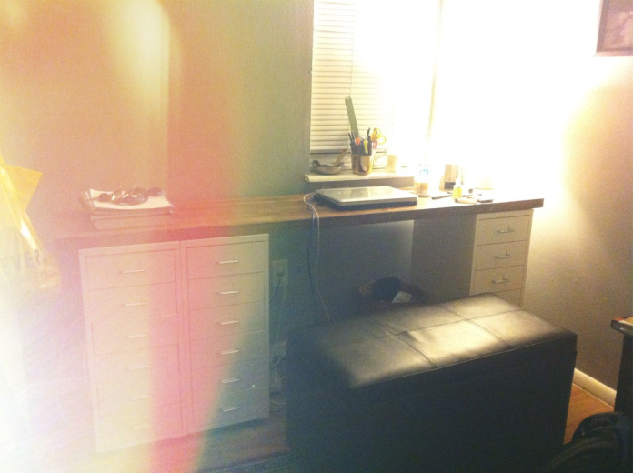 My DIY desk spans the length of one wall in my teeny, tiny bedroom.