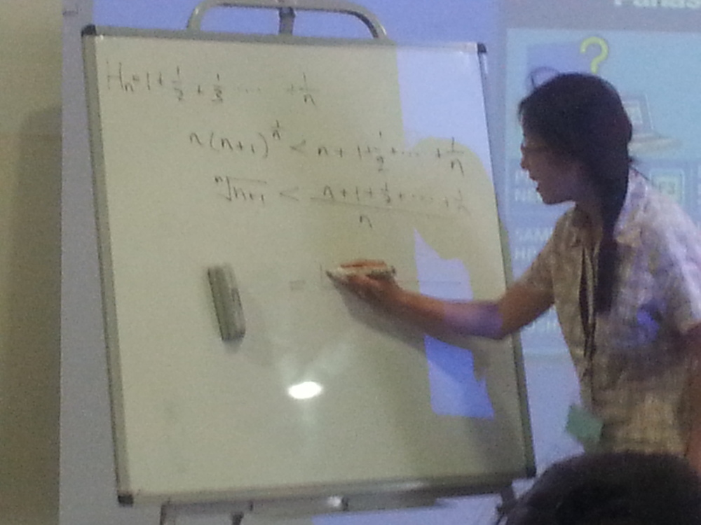 May Meng inspiring the Juniors with an inspiring problem. Does anyone want to try? The problem is trying to prove the inequality on the second line.