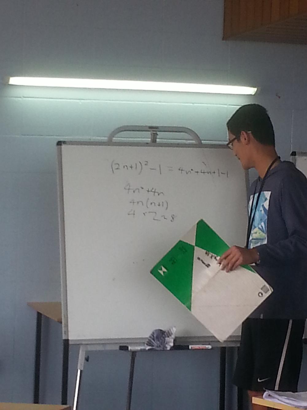 Tony Wang explaining an alternate solution