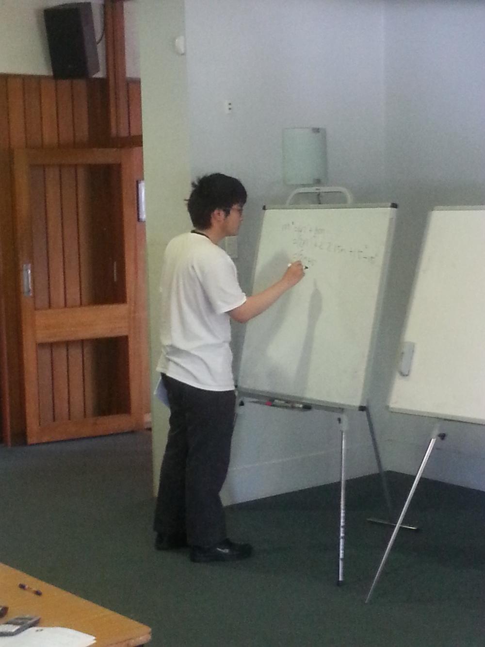 Xuzhi Zhang explaining an alternative solution toQuestion 4
