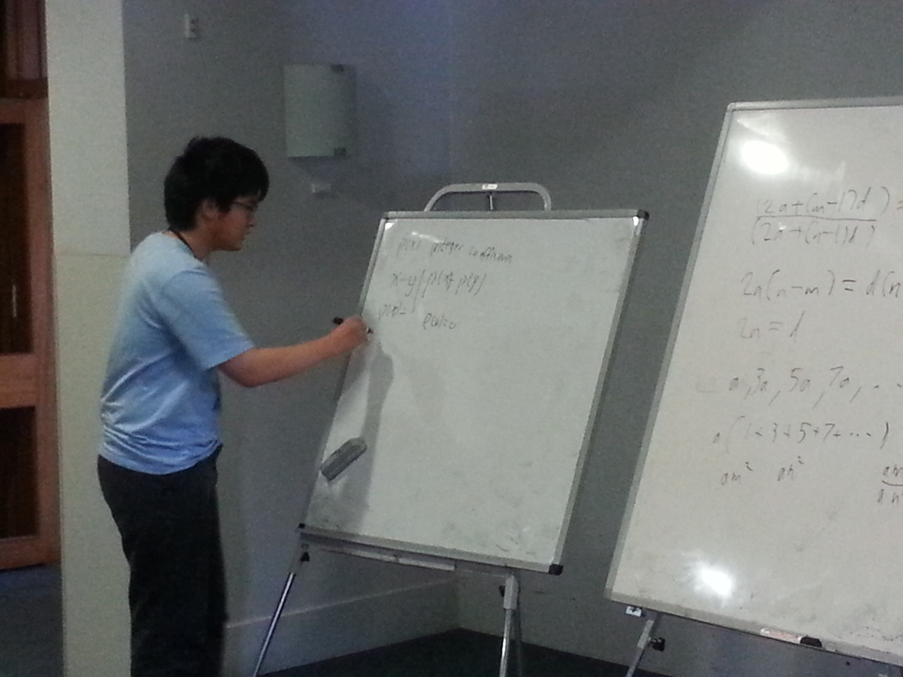 Xuzhi Zhang presenting a solution to Problem 4