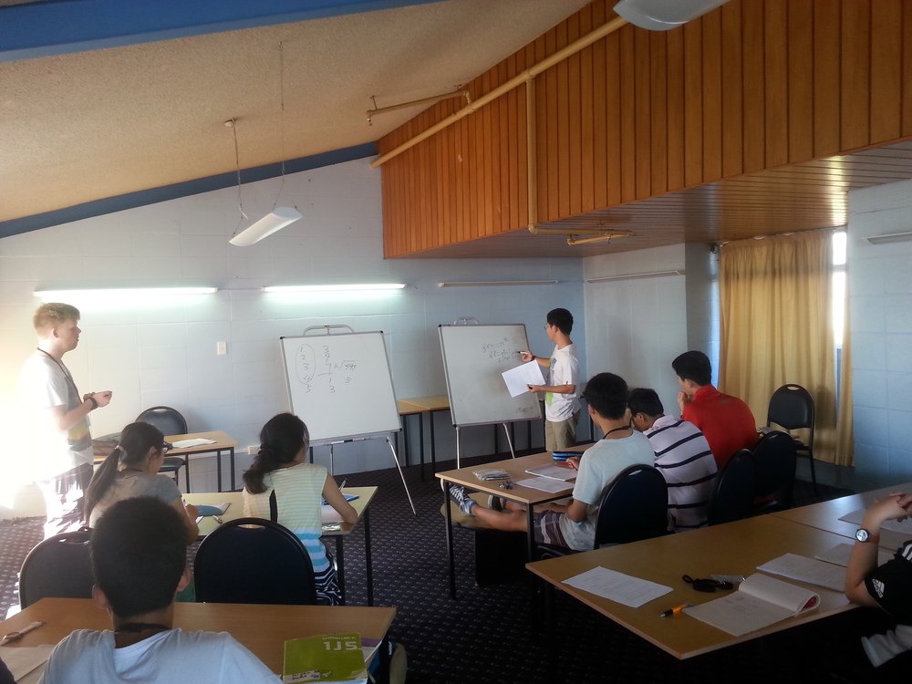 Hao Jia (right standing) presenting a solution to an exercise problem