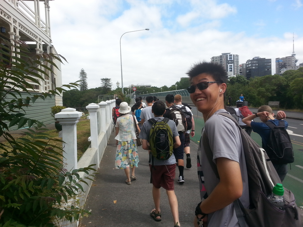 Walking to the bus stop in order to bus to the ferry port