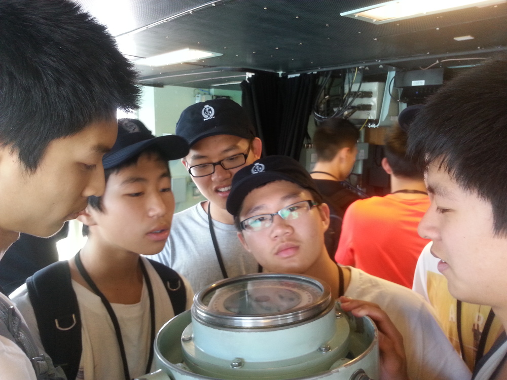 Students looking at a massive compass (from left: Kevin Shen, Brian Qi, George Han, Hao Jia, Gary Qian)