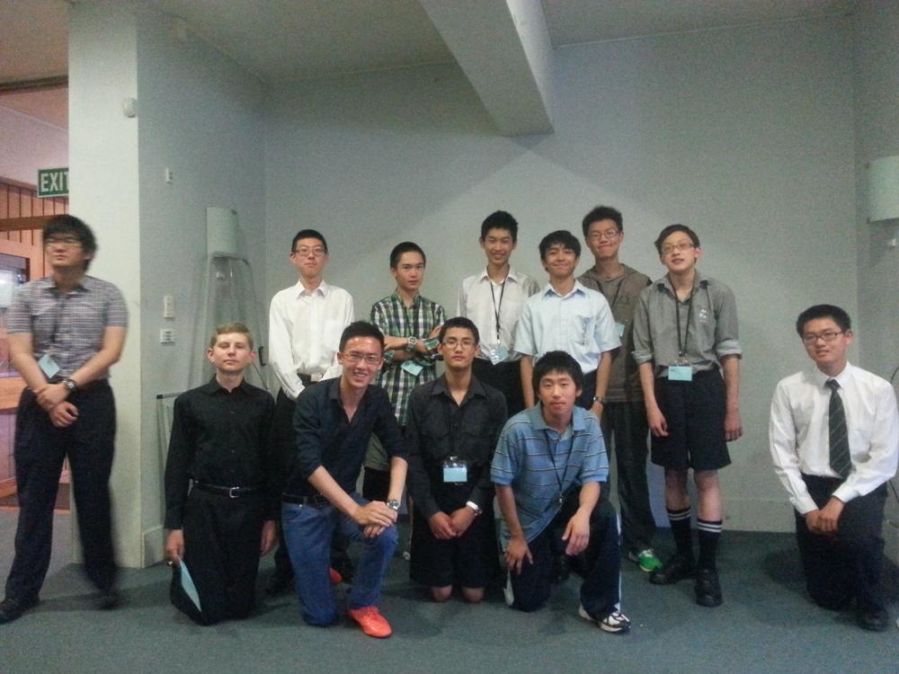 IMO squad 2015 (from left: (standing) Xuzhi Zhang, William Wang, Miles Lee, Kevin Shen, Prince Michael Balanay, Chris Wan, Edward Chen;(sitting) Keiran Lewellen, Martin Luk, Tony Wang, Brian Qi, George Han)