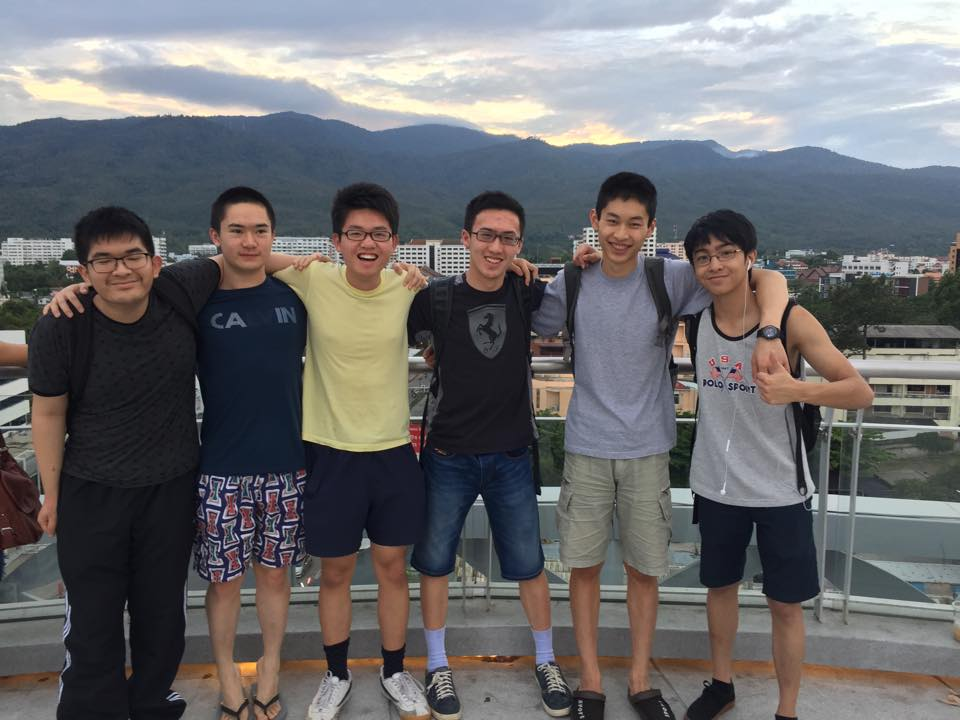Team photo at the top of a mall, with the surrounding mountains of Chiang Mai as the backdrop
