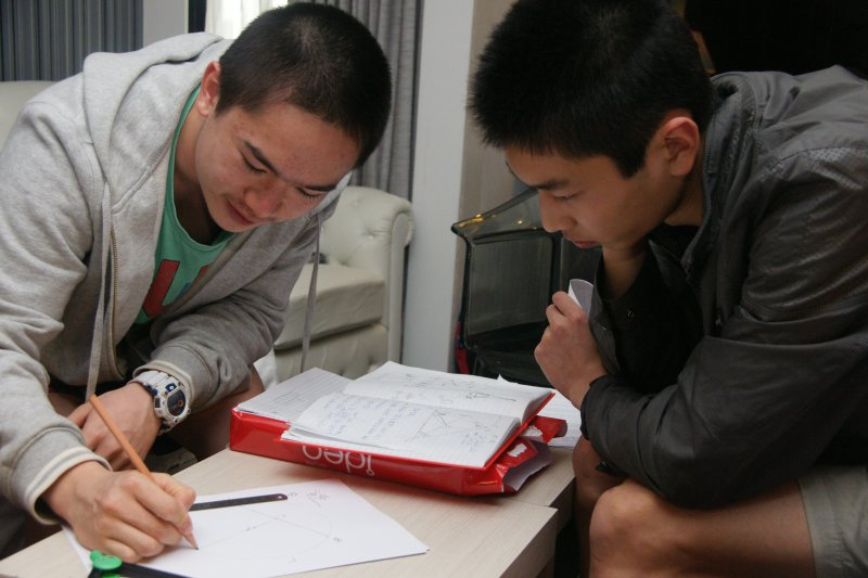 Miles Lee and Kevin Shen work together on a problem