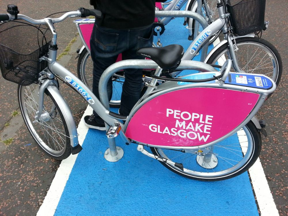 Photo of a Nextbike (not the one I used) taken outside the Glasgow Green Templeton Station ( photo credit: Michael Doherty )