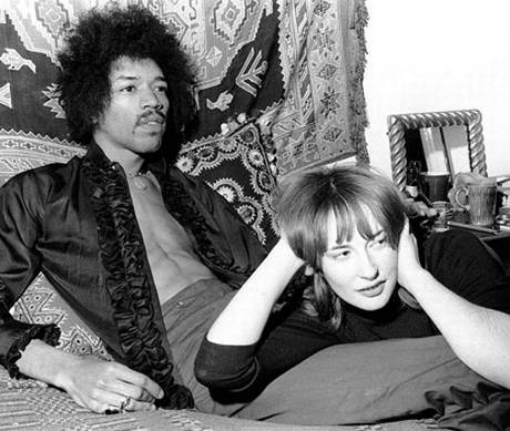 Jimi Hendrix and Kathy Etchingham in their home