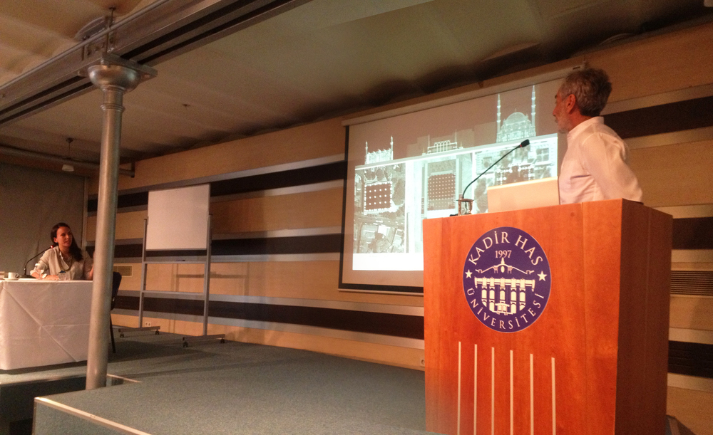 Seher simultaneously translating the architect Nevzat Sayın's lecture from Turkish to English