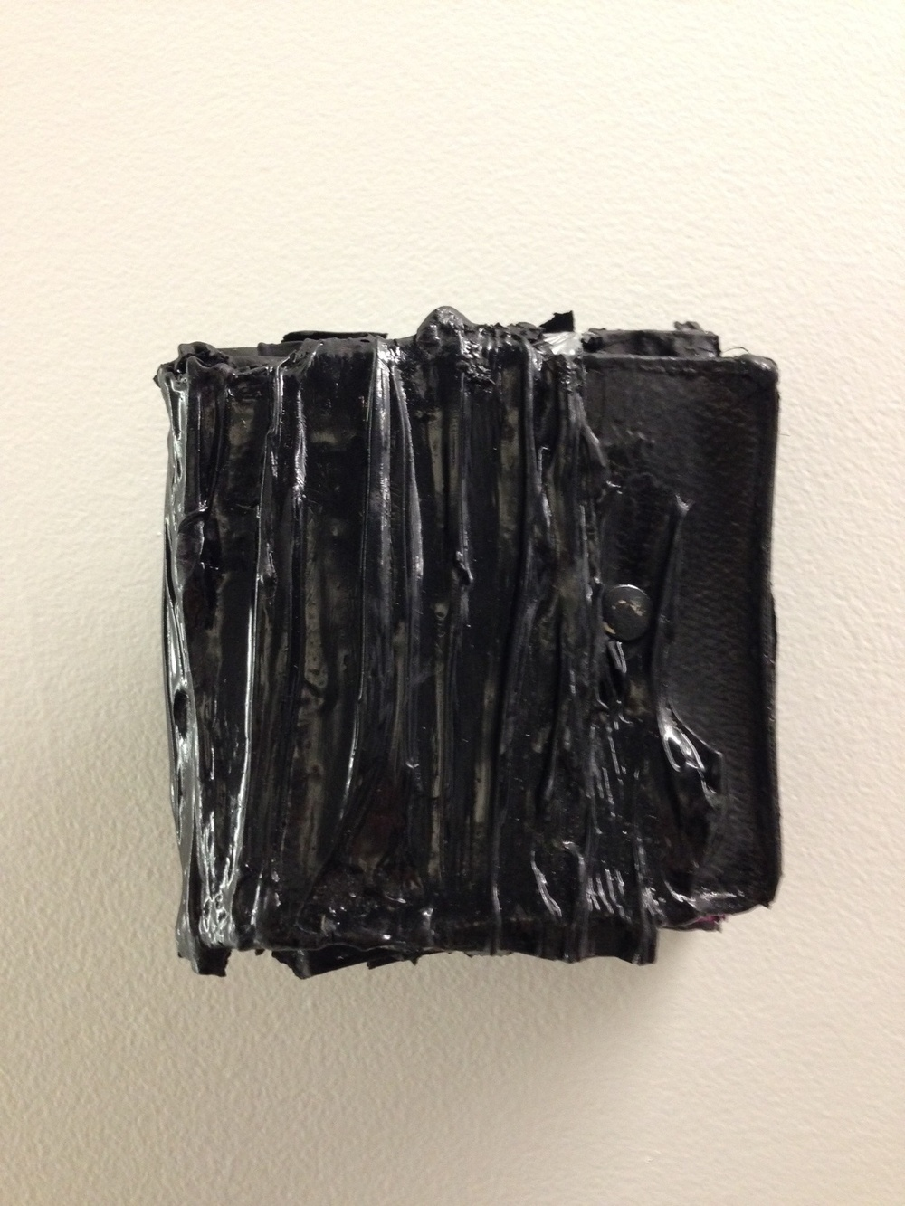 "Gabriel J. Shuldiner POST_FAIL postapocalypticblack, modified acrylic polymer emulsion, carbon black pigment, gesso, alkyd enamel, latex enamel, krink ink, high heat engine enamel, artist's own recycled Louis Vuitton canvas wallet, blackened steep roofing nail 4.5"" x 4.5"" x 3"" 2015"