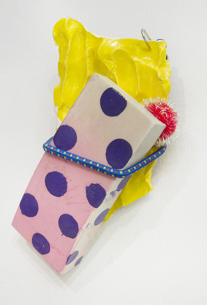 "Gripped , 2017 Glazed ceramic, PVC pipe scrap, ink, spray paint, resin, pompom and bungee cord 7"" x 4"" x 2"" Soho20 Gallery"