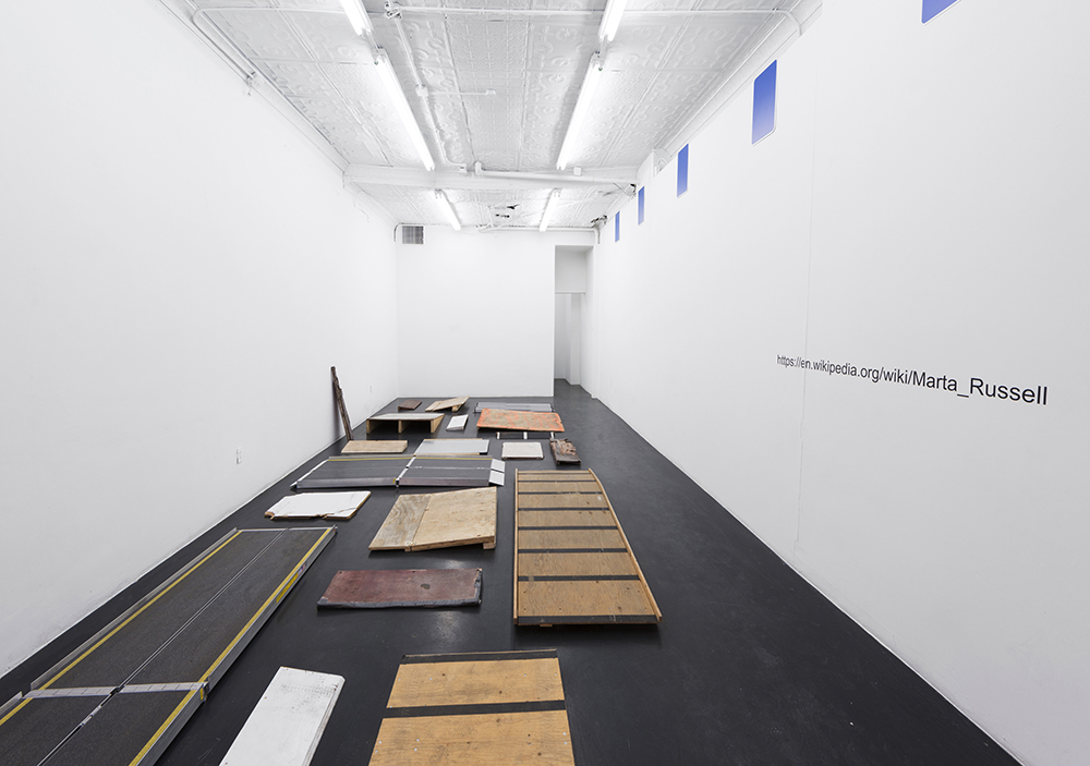 Ramps , 2014, industrial and handmade temporary access ramps, digital print on dibond (blue signs), wall vinyl, variable